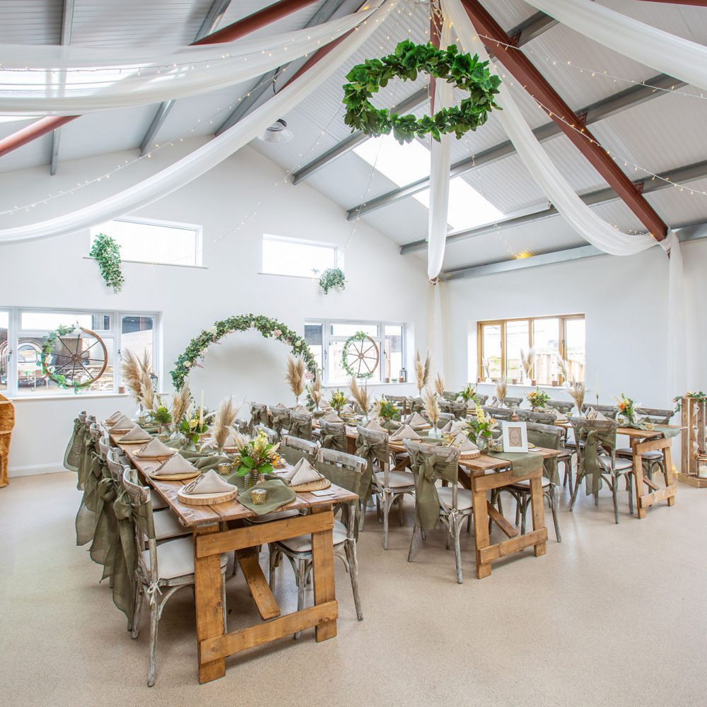 The New Barn was converted in 2019 and has large open plan space with an outlook and access to the rear courtyard. It is light and spacious with a high vaulted ceiling in the main part. It is ideally suited for weddings of 30 to 120 guests